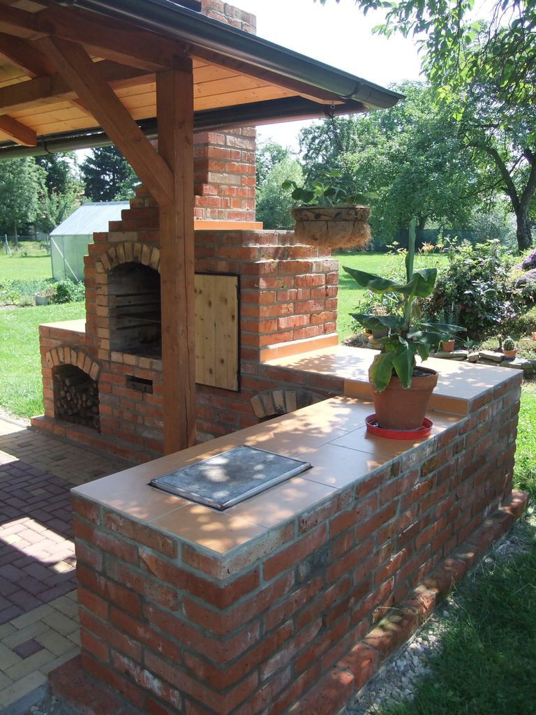 DIY Fireplace Outdoor  DIY outdoor fireplace with grill