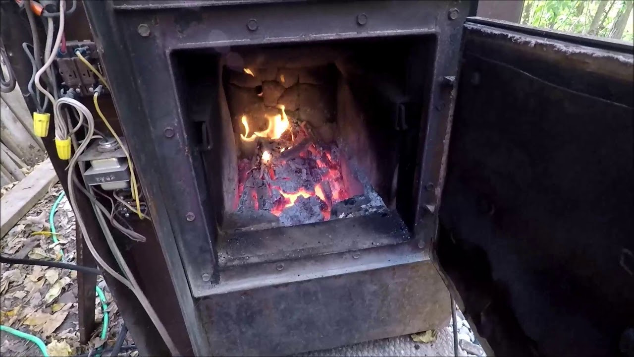DIY Outdoor Wood Furnace  DIY Outside wood burning forced air furnace FREE HEAT in