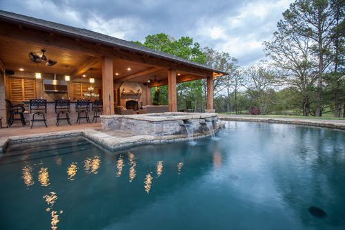 Pool With Outdoor Kitchen  Rustic Mississippi Pool House Landscaping Network