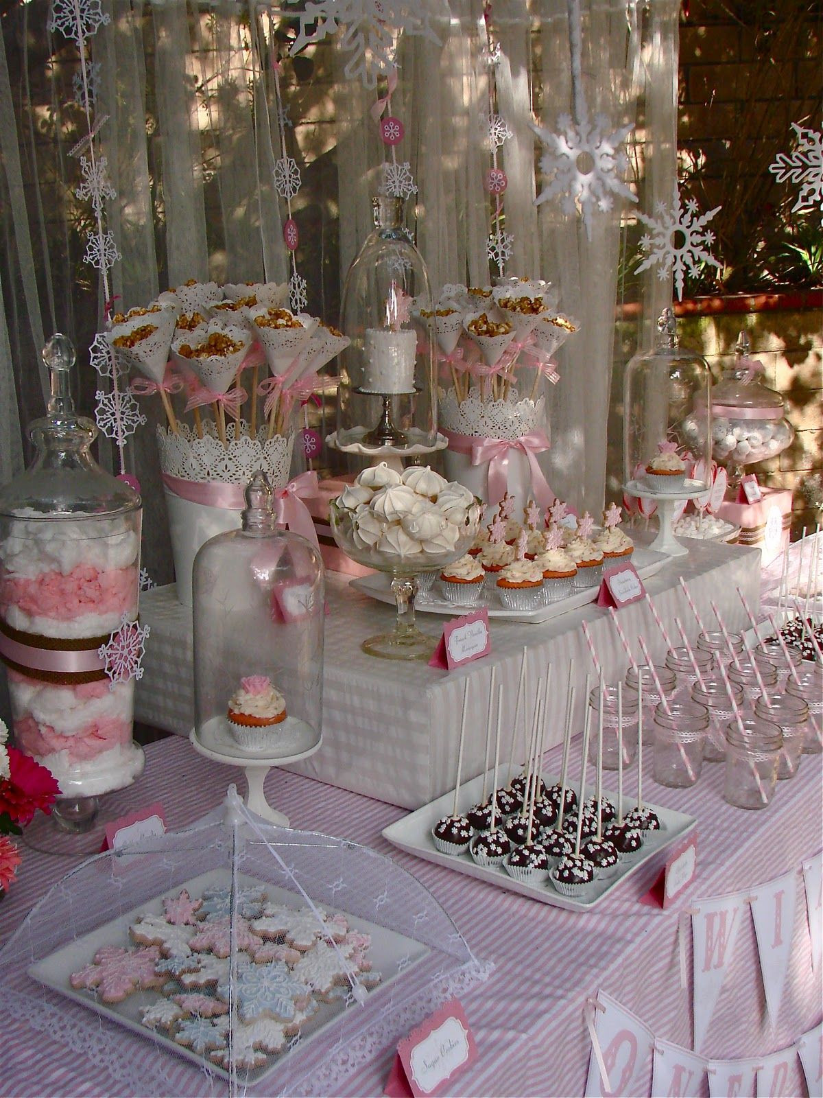Winter Birthday Party Ideas For 1 Year Old  I am in love with this pretty in pink Winter e derland