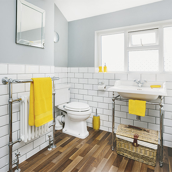 Yellow And Gray Bathroom Decor  White and grey bathroom with yellow accents and faux wood